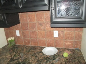 Butler Pantry With dark tile before